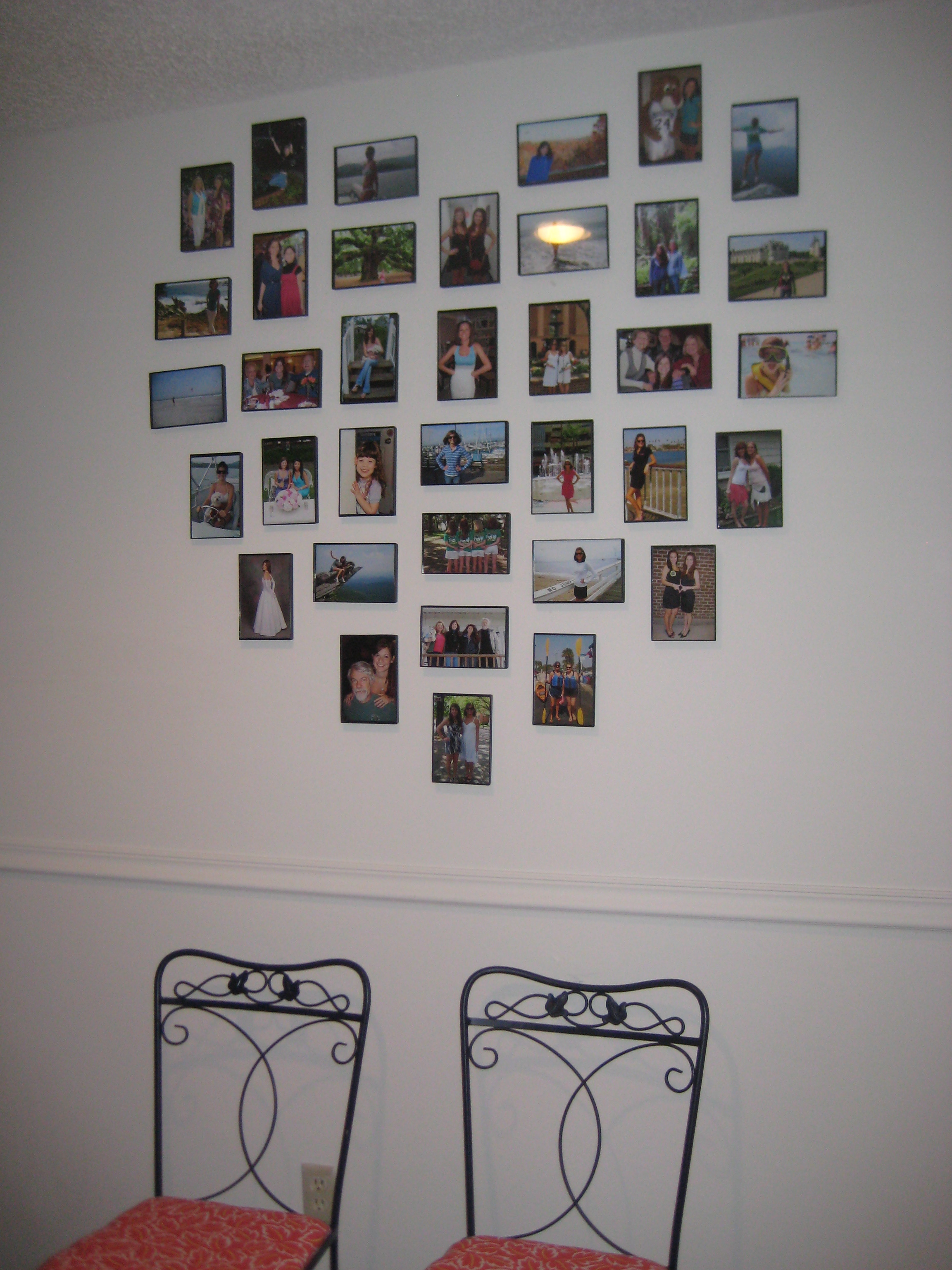 A lovely arrangement charleston crafted for Arrangement of photo frames on wall